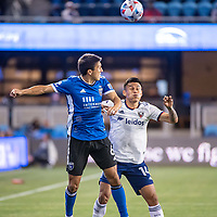 SAN JOSE, CA - MAY 01: Shea Salinas #6 of the San Jose Earthquakes heads the ball with Andy Najar #14 of DC United during a game between San Jose Earthquakes and D.C. United at PayPal Park on May 01, 2021 in San Jose, California.