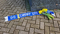 Pictured: A Cardiff scarf and flowers left by the statue of Fred Keenor outside the Cardiff City Stadium in south Wales, UK. Tuesday 22 January 2019<br /> Re: Premier League footballer Emiliano Sala was on a flight which disappeared between France and Cardiff.<br /> The Argentine striker was one of two people on board the Piper Malibu, which disappeared off Alderney on Monday night.<br /> Cardiff City FC, signed the 28-year-old from French club Nantes.<br /> A search is under way.<br /> A Cardiff Airport spokeswoman confirmed the aircraft was due to arrive from Nantes but said there were no further details.<br /> HM Coastguard has sent two helicopters to help.