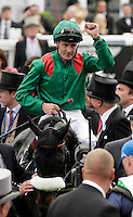 Pat Smullen celebrates after riding Harzand to victory in the 4.30 Investec Derby <br /> Ippica Investec Derby meeting taking place at Epsom Downs Racecourse -  06/04/2016 <br /> Foto Henry Browne / Action Images / Panoramic / Insidefoto
