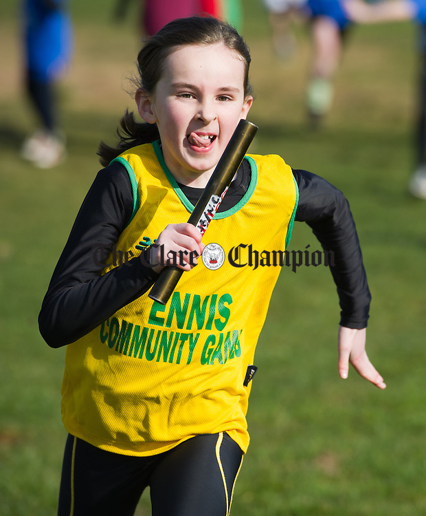 Determination on then face of a competitor  in a relay race at the Clare Community Games Cross Country and Relay finals in Lees Road. Photograph by John Kelly.