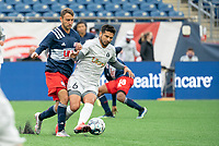 FOXBOROUGH, MA - APRIL 17: Christian Malfa #38 of New England Revolution II collides with Zaca Moran #6 of Richmond Kickers in a tackle during a game between Richmond Kickers and Revolution II at Gillette Stadium on April 17, 2021 in Foxborough, Massachusetts.
