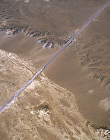 aerial photograph of a truck crossing desert highway near Death Valley National Park California