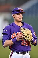 Left fielder Seth Beer (28) of the Clemson Tigers warms up before a game against the Michigan State Spartans on Wednesday, March 8, 2017, at Fluor Field at the West End in Greenville, South Carolina. Clemson won, 9-2. (Tom Priddy/Four Seam Images)
