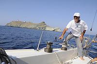 - sailing boat in navigation near the Giraglia island (Corsica)....- barca a vela in navigazione presso l'isola della Giraglia (Corsica)