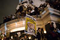 Demonstrators at Place de la Republique following the massacre at Charlie Hebdo in Paris where masked gunmen killed 12 people. Paris, France, (Jan. 7, 2015).