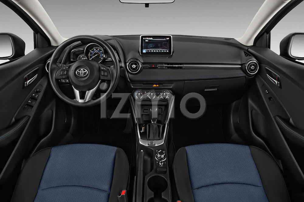 Stock photo of straight dashboard view of 2018 Toyota Yaris-iA AT 4 Door Sedan Dashboard