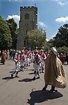 Hooden Horse East Kent Morris dancers, Charing, Kent, UK 2013. David Rivers inside Invicta the Hooden Horse, so called after the emblem of Kent.