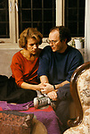 """British director Anthony Minghella, holding hands with British actress Juliet Stevenson in film set of """"Truly Madly Deeply""""."""