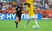 Tobin Heath (l) of team USA and Maurine of team Brazil during the FIFA Women's World Cup at the FIFA Stadium in Dresden, Germany on July 10th, 2011.