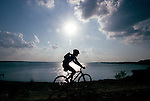 Jimmy Morgan  of Copper Canyon is silhouetted by the afternoon sun as he rides the Northshore trail near the Rockledge Park end on Wednesday May 31, 2000.  He rides here about two to three times a month.  .Star-Telegram/Khampha Bouaphanh