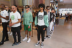 """Fashion designer Ricardo Seco (second from left) being interviewed at his Ricardo Seco Spring Summer 2019 """"Vision"""" collection fashion presentation in Flying Solo, in New York City, on July 9, 2018; during New York Fashion Week: Men's Spring Summer 2019."""