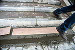 KRASNAYA POLYANA, RUSSIA  - JANUARY 5:<br /> A man walks past a newly-poured cement steps at the Gorky Gorod hotel complex in the Mountain Cluster before the start of the 2014 Sochi Olympics Wednesday February 5, 2014<br /> (Photo by Chris Detrick/The Salt Lake Tribune)