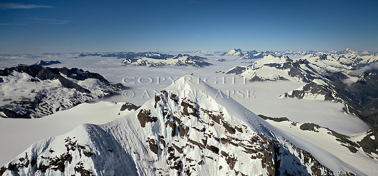 Two climbers on the summit of Mount Aspiring. Mount Aspiring National Park Otago New Zealand.