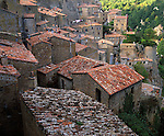 Tuscany, Italy<br /> Tiled roofs on the terraced houses of Sorano, a hill town in southern tuscany