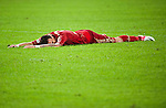 GUANGZHOU, GUANGDONG - JULY 26:  Mario Mandzukic of Bayern Munich lies on the pitch during a friendly match against VfL Wolfsburg as part of the Audi Football Summit 2012 on July 26, 2012 at the Guangdong Olympic Sports Center in Guangzhou, China. Photo by Victor Fraile / The Power of Sport Images
