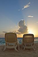 Sun lounger on tropical beach at sunrise, Punta Cana, Dominican Republic
