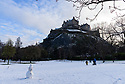 Socially distanced snowmen enjoy the festive weather in Edinburgh's Princes Street Gardens, in front of Edinburgh Castle. This is the first snowfall of the first Covid Winter in Edinburgh. Edinburgh has been placed in Tier 4 restrictions due to the Covid-19 pandemic