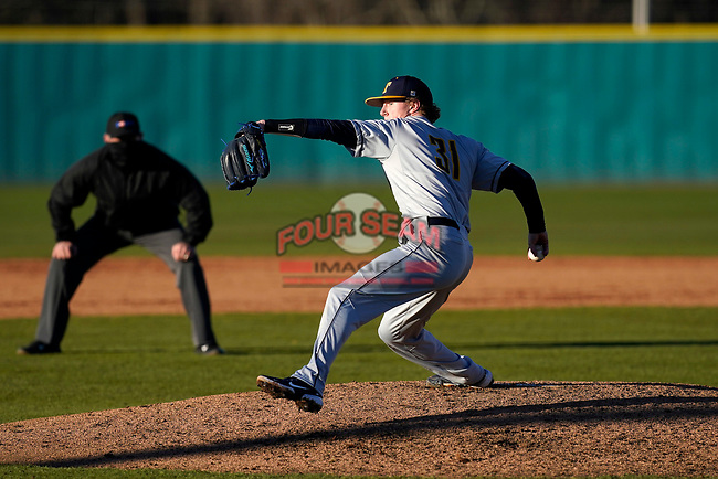 Nate Boyle (31) of the University of Toledo Rockets pitches in a game against the University of South Carolina Upstate Spartans on Friday, February 19, 2021, at Cleveland S. Harley Park in Spartanburg, South Carolina. Upstate won, 14-2. (Tom Priddy/Four Seam Images)
