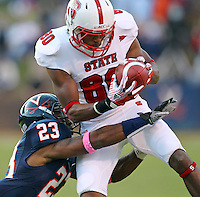 Oct. 22, 2011 - Charlottesville, Virginia - USA; North Carolina State wide receiver Bryan Underwood (80) makes a touchdown catch next to Virginia Cavaliers cornerback Dom Joseph (23) during an NCAA football game at the Scott Stadium. NC State defeated Virginia 28-14. (Credit Image: © Andrew Shurtleff/