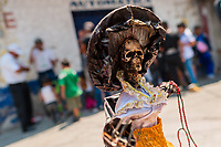 A statue of Santa Muerte (Holy Death) is seen placed on the street during a religious pilgrimage in Tepito, Mexico City, Mexico, 1 April 2018. The religious cult of Santa Muerte is a fusion of Aztec death worship rituals and Catholic beliefs. Born in lower-class neighborhoods of Mexico City, it has always been closely associated with crime. In the past decades, original Santa Muerte followers, such as prostitutes, pickpockets and street drug traffickers, have merged with thousands of ordinary Mexican Catholics. The Holy Death veneration, offering a spiritual way out of hardship in modern society, rapidly expanded. Although the Catholic Church still considers Santa Muerte followers the devil worshippers, on the first day of every month, crowds of Santa Muerte believers fill the streets of Tepito. Holding statues of Holy Death clothed in a long robe, they pray for healing, protection, money or any other favor in life.