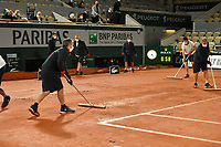 3rd October 2020, Roland Garros, Paris, France; French Open tennis, Roland Garros 2020;  The court is worked on by groundskeepers after the rain during the Djokovic versus Galan match