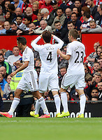 Pictured: Ki Sung Yueng celebrating his goal with team mates. Saturday 16 August 2014<br />