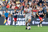 FOXBOROUGH, MA - JULY 7: Alejandron Pozuelo #10 of Toronto FC looks to pass during a game between Toronto FC and New England Revolution at Gillette Stadium on July 7, 2021 in Foxborough, Massachusetts.