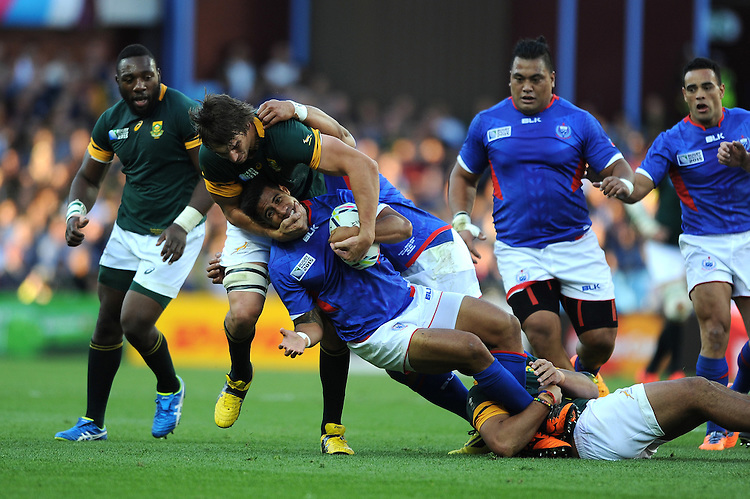 Victor Matfield of South Africa tackles Ken Pisi of Samoa around the neck during Match 15 of the Rugby World Cup 2015 between South Africa and Samoa - 26/09/2015 - Villa Park, Birmingham<br /> Mandatory Credit: Rob Munro/Stewart Communications