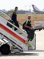 Wednesday 18 September 2013<br /> Pictured L-R: Players Alvaro Vazquez and Chico Flores disembark from the aeroplane upon their arrival to Valencia, Spain.<br /> Re: Swansea City FC players and staff travelling to Spain for their UEFA Europa League game against Valencia.