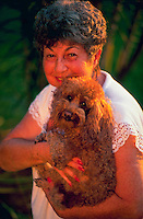 Portrait of an elderly woman with her poodle.
