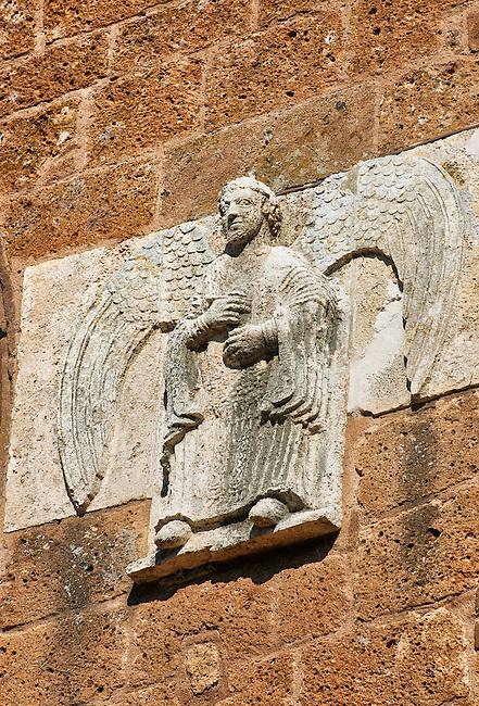 13th century angel sculptures on the facade of the Romanesque Basilica Church of Santa Maria Maggiore, Tuscania