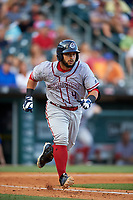 Syracuse Chiefs catcher Jhonatan Solano (4) runs to first base during a game against the Buffalo Bisons on July 3, 2017 at Coca-Cola Field in Buffalo, New York.  Buffalo defeated Syracuse 6-2.  (Mike Janes/Four Seam Images)