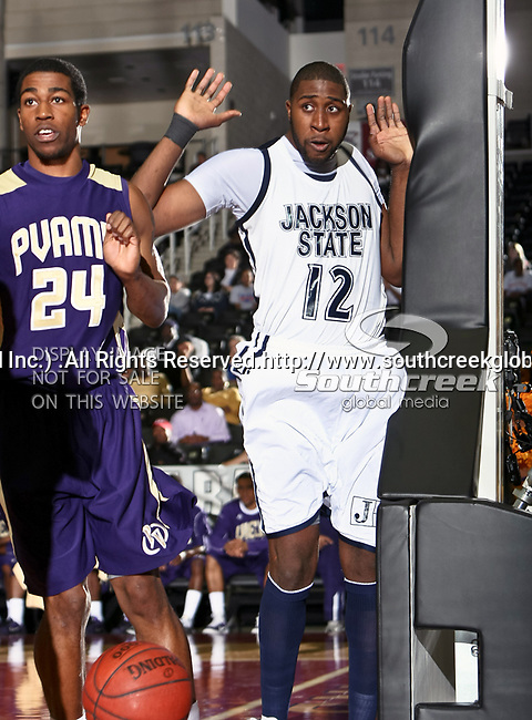 Jackson State Tigers center Gertavian Blake (12) and Prairie View A & M Panthers guard Duwan Kornegay (24) in action during the SWAC Tournament game between the Prairie View A & M Panthers and the Jackson State Tigers at the Special Events Center in Garland, Texas. Jackson State defeats Prairie View A & M 50 to 38.