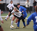 Carson's Michelle Sandage and Katie Dry of Douglas battle for the ball during the girls soccer zone championship at Damonte Ranch High School in Reno, Nev. on Saturday, Nov. 5, 2011 . Carson won 2-1..Photo by Cathleen Allison