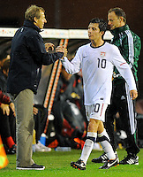 Jose Torres (r) and coach Jurgen Klinsmann - substitution of team USA during the friendly match Belgium against USA at King Baudoin stadium in Brussel, Belgium on September 06th, 2011.