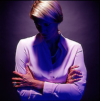 Dramatically lit blond woman with face in shadow<br />