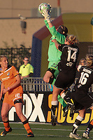 Sky Blue keeper Jenni Branam makes a save as Flash players Becky Edwards & Gemma Davison, drives to the ball. the match played in Rochester, NY ended in a 2-2 tie