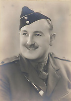 BNPS.co.uk (01202 558833)<br /> Pic: C&TAuctions/BNPS<br /> <br /> Pictured: Lt Bain, centre. <br /> <br /> The medals and personal effects of an unsung hero of D-Day have emerged for sale for £6,000.<br /> <br /> Lieutenant Colonel Douglas Bain trialled the amphibious Duplex Drive tanks ahead of the Normandy landings in June 1944.<br /> <br /> He commanded three DD training schools preparing tanks for sea and river assaults, reporting personally to Field Marshal Bernard Montgomery.<br /> <br /> The dangerous trials, which tested the 'waterproofing' of the amphibious armoured vehicles, were carried out off the south coast of England.