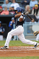 Asheville Tourists Russell Wilson #3 swings at a pitch during a game against  the Lexington Legends at McCormick Field in Asheville,  North Carolina;  April 16, 2011. Lexington defeated Aheville 13-7.  Photo By Tony Farlow/Four Seam Images