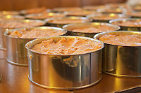How to make foie gras duck's liver (series of images): Conserve tins cans filled with duck liver ready to be sealed and heated for conservation. Ferme de Biorne duck and fowl farm Dordogne France Workshop on how to make foie gras duck liver pate and other conserves