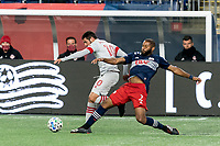 FOXBOROUGH, MA - OCTOBER 7: Andrew Farrell #2 of New England Revolution disrupts pass to Alejandro Pozuelo #10 of Toronto FC during a game between Toronto FC and New England Revolution at Gillette Stadium on October 7, 2020 in Foxborough, Massachusetts.