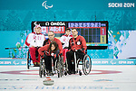Sochi, RUSSIA - Mar 8 2014 -  Ina Forrest takes a shot as Mark Ideson looks on as Canada takes on Russia in Wheelchair Curling during the 2014 Paralympic Winter Games in Sochi, Russia.  (Photo: Matthew Murnaghan/Canadian Paralympic Committee)