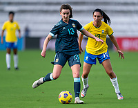 ORLANDO, FL - FEBRUARY 18: Sophia Braun #13 of Argentina passes the ball during a game between Argentina and Brazil at Exploria Stadium on February 18, 2021 in Orlando, Florida.