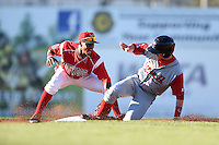 Batavia Muckdogs second baseman Mason Davis (7) tags out Danny Mars (39) attempting to steal second during a game against the Lowell Spinners on July 16, 2014 at Dwyer Stadium in Batavia, New York.  Lowell defeated Batavia 6-4.  (Mike Janes/Four Seam Images)