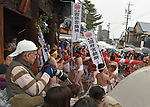February  20th, 2016, Inazawa, Japan - Participants of Naked Man festival are carrying a big bamboo pole, wrapped in long pieces of cloth towards the main gate of Konomiya Shrine on Saturday, February 20, 2016.<br /> The festival organised by Konomiya Shrine, takes place annually on the 13th of the lunar calendar. It is one of the oldest festivals in Japan. Since the old days, the participants are men only, mostly of the ages 24, 42 and 61, which are considered unlucky in Japan. By taking part in the festival they are hoping to avoid the bad luck throughout the coming year.