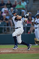 Diego Castillo (2) of the Somerset Patriots follows through on his swing against the Altoona Curve at TD Bank Ballpark on July 24, 2021, in Somerset NJ. (Brian Westerholt/Four Seam Images)