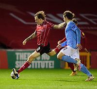 Lincoln City's Harry Anderson vies for possession with  Manchester City U21's Adrian Berbnabe<br /> <br /> Photographer Andrew Vaughan/CameraSport<br /> <br /> EFL Papa John's Trophy - Northern Section - Group E - Lincoln City v Manchester City U21 - Tuesday 17th November 2020 - LNER Stadium - Lincoln<br />  <br /> World Copyright © 2020 CameraSport. All rights reserved. 43 Linden Ave. Countesthorpe. Leicester. England. LE8 5PG - Tel: +44 (0) 116 277 4147 - admin@camerasport.com - www.camerasport.com