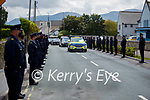 The guard of honour at Paudie Twohigs by his Garda colleagues in Killarney on Tuesday.