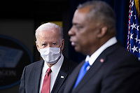 US President Joe Biden (L) listens to US Secretary of Defense Lloyd Austin (R) deliver remarks to Department of Defense personnel at the Pentagon in Arlington, Virginia, USA, 10 February 2021.<br /> CAP/MPI/RS<br /> ©RS/MPI/Capital Pictures