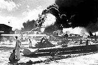 Captured Japanese photograph taken during the attack on Pearl Harbor, December 7, 1941.  In the distance, the smoke rises from Hickam Field.  (Navy)<br /> NARA FILE #:  080-G-19948<br /> WAR & CONFLICT BOOK #:  1134